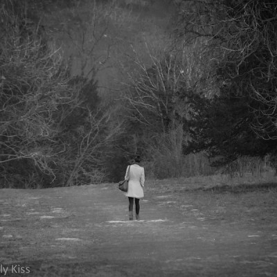 woman walking in countryside alone