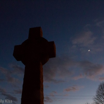 Church cross in the moonlight