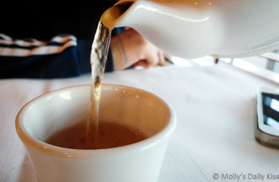 pouring bitter tea into a cup