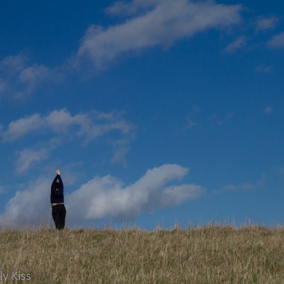Woman standing tall in field