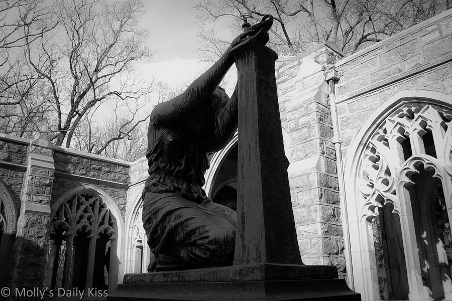 Woman kneeling statue
