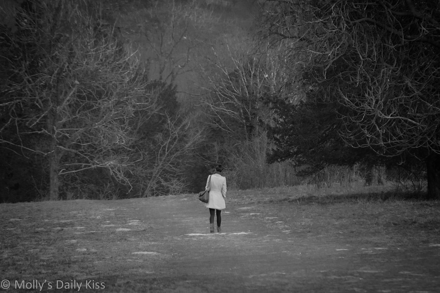 woman walking in countryside alone. Promise
