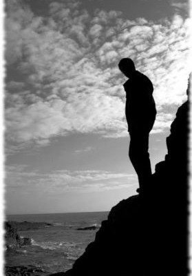 Silhouette of man stanind on rocks