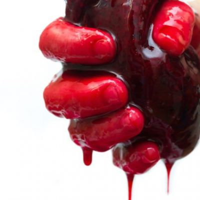 hand holding bleeding heart