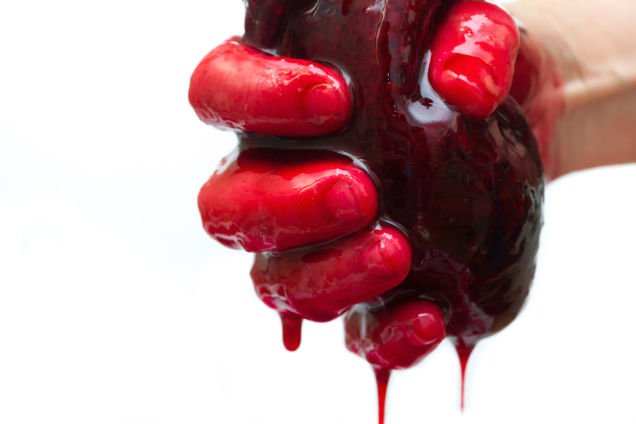 hand holding bleeding heart
