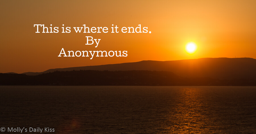 Sunset over the sea with the words This is where it ends by anonymous written in the sky